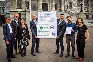 A photo of people from Zero Carbon Act partner organisations delivering the petition to Scott Simpson MP and Minister James Shaw