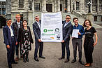 A photo of people from Zero Carbon Act partner organisations delivering the petition to Scott Simpson MP and Minister James Shaw<br />© WWF-New Zealand / Sarah Meads