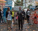 WWF-New Zealand CEO Livia Esterhazy standing beside climate open letter to Minister James Shaw and passing him the climate open letter