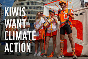Photo of Zero Carbon Act campaigners outside the NZ Parliament with the words