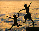 Children dive into the sea at sunset, Funafuti, Tuvalu; Child;
