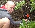 Robbie Grieg from Goodnature Traps check a rat_stoat trap on Wellington's south coast